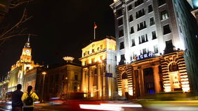 Traffic in historic buildings at night in Shanghai stock video