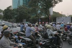Traffic in Ho Chi Minh, Vietnam at end of the day Royalty Free Stock Image