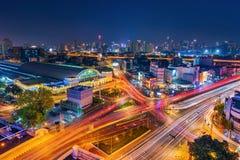 Traffic at Hua Lamphong intersection and Hua Lamphong railway station at night in Bangkok, Thailand royalty free stock photos