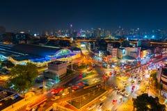 Traffic at Hua Lamphong intersection and Hua Lamphong railway station at night in Bangkok, Thailand stock image