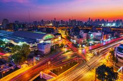 Traffic at Hua Lamphong intersection and Hua Lamphong railway station with sunrise in Bangkok, Thailand stock photo