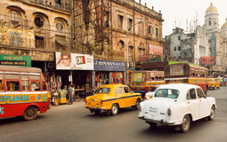 Traffic on indian road with markets and speeding antique Ambassador cars Royalty Free Stock Photo