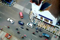 Traffic intersection with cars and motorcycles. In asia afrika street, bandung, Indonesia in tilt shit, miniature Royalty Free Stock Image