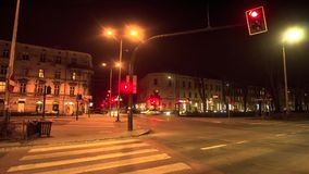 Traffic at the intersection in the center of Krakow at night. stock video footage