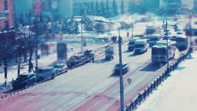Traffic at an intersection in winter. Traffic is at a crossroads in the winter. Timelapse with slow shutter speed on a sunny winter day stock video footage