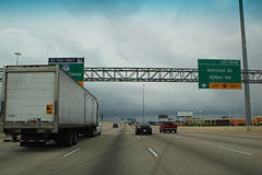 Traffic on Interstate 10, Houston, Texas. Traffic driving on Interstate 10 through Houston, Texas on overcast, stormy day Stock Photo
