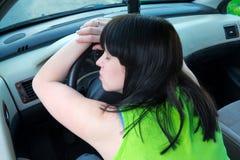 Traffic Jam. Woman sleeps in a car Stock Photography