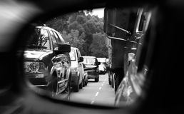 Traffic jam. Black and white image of a traffic jam seen over a mirror Stock Images