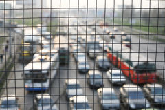 Traffic jam. Shooted through the cage on the Kiev royalty free stock image