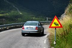 Traffic jam ahead warning sign near Ullensvang, Norway. Ullensvang, Norway - June 22, 2018: Traffic jam ahead warning road sign on a narrow coastal road along stock image