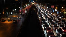 Traffic jam on the Avenue at rush hour in the city center at night time, urban cityscape.  stock footage