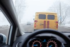 Traffic jam in bad weather driving in winter Stock Photos