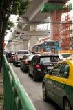 Traffic jam below construction blue line of bangkok sky train Royalty Free Stock Photos