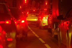 Traffic jam at big city back view. Traffic jam at the city centre back view at the night Royalty Free Stock Image