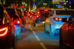 Traffic jam at big city back view. Traffic jam at the city centre back view at the night Royalty Free Stock Photo