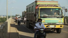 Traffic jam , bridge,  truck ,  cambodia. Southeast asia, Cambodia, Kampong cham town, november 2013. Cambodian road traffic in Kizuna bridge stock video