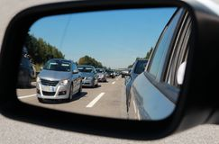 Traffic jam in a car mirror Stock Image