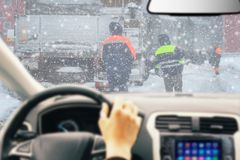 Traffic jam caused by heavy snowfall. Driver view stock photos