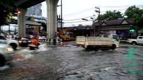 Traffic jam caused from rain flooding. Bangkok, Thailand - MAY 25,2017 : Terrible flooding in early morning on workday caused from heavy rainy all night stock video footage