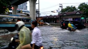 Traffic jam caused from rain flooding. Bangkok, Thailand - MAY 25,2017 : Terrible flooding in early morning on workday caused from heavy rainy all night stock footage
