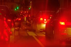 Traffic jam at big city back view. Traffic jam at the city centre back view at the night Stock Photos