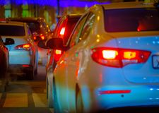 Traffic jam at big city back view. Traffic jam at the city centre back view at the night Royalty Free Stock Images
