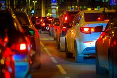 Traffic jam at big city back view. Traffic jam at the city centre back view at the night Stock Image