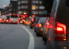 Traffic jam in city during rush hour. Cars waiting in line at a red light during rush hour commuting Royalty Free Stock Image