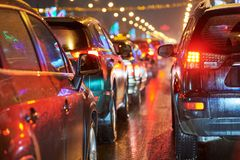 Traffic jam or collapse in a city street road on holiday. Traffic jam or automobile collapse with rows of cars in a city street during rush hour. Wet danger road Royalty Free Stock Images