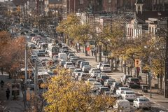 Traffic jam on College Street in Downtown Toronto, Ontario, Canada, made of cars and streetcars, during rush hour