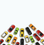 Traffic jam concept with multiple toy cars on white background Royalty Free Stock Image