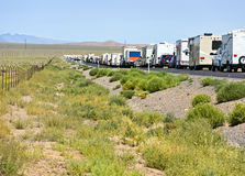 Traffic jam in the desert. First day of Burning Man event, waiting in traffic for miles Royalty Free Stock Photo