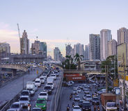Traffic jam in the evening with high-rise building in background Stock Photography
