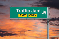 Traffic Jam Exit Only Freeway Sign with Sunrise Sky Royalty Free Stock Photography