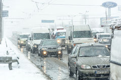 Traffic jam formed at the road caused by a heavy snowstorm. Stock Images
