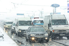 Traffic jam formed at the road caused by a heavy snowstorm. Royalty Free Stock Photography