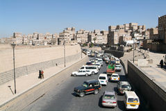 Traffic jam in front of the decorated houses of old Sana Stock Photography