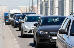 Traffic jam. Generic cars standing in a queue during traffic jam royalty free stock photo