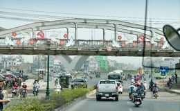 The traffic jam at Hanoi. Arched steel bridge with communist symbols  hammer and sickle  on the outskirts of Hanoi - Vietnam Stock Image