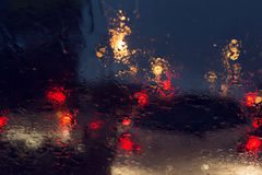 Traffic jam in heavy rainy day on city street at night Stock Images