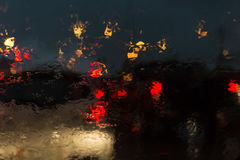 Traffic jam in heavy rainy day on city street at night Royalty Free Stock Image