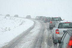 Traffic jam in heavy snowfall on mountain road Royalty Free Stock Image