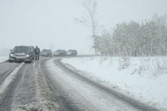 Traffic jam in heavy snowfall on mountain road Stock Image