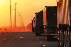 Traffic Jam of Heavy Trucks. In Sunset Royalty Free Stock Photos