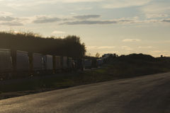 Traffic Jam of Heavy Trucks at Sunset - wide angle Royalty Free Stock Photo