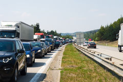 Traffic jam. A traffic jam on a highway with rows of cars in one direction stock photos