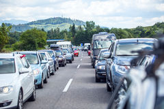 Traffic jam on the highway in the summer holiday period or in a traffic accident. Slow or bad traffic Royalty Free Stock Photos