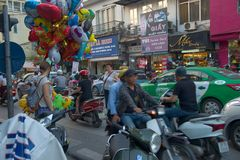 Traffic Jam in Ho Chi Minh City Vietnam. People on motorbikes in Saigon - Vietnam Stock Photo
