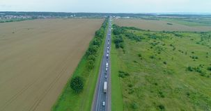 Traffic jam in long distance route aerial view. Daytime stock footage