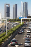 Traffic jam in Madrid with four towers skyline Royalty Free Stock Image